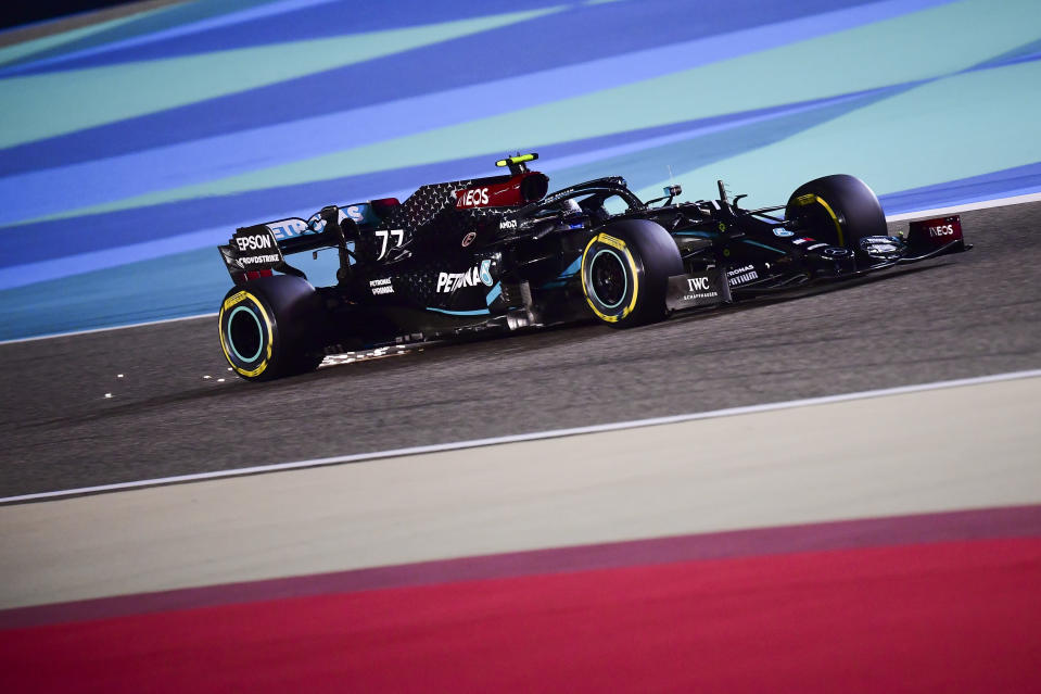 Mercedes driver Valtteri Bottas of Finland steers his car during the qualifying session at the Formula One Bahrain International Circuit in Sakhir, Bahrain, Saturday, Nov. 28, 2020. (Giuseppe Cacace, Pool via AP)