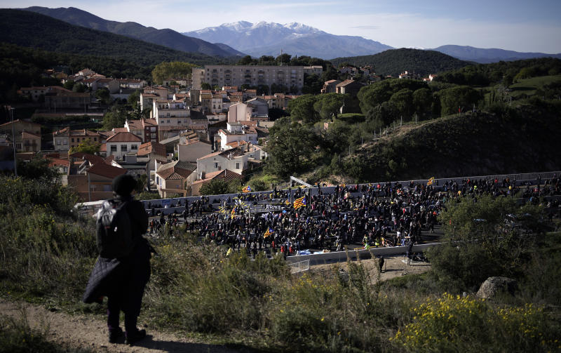 Pro-Catalan independence demonstrators block a major highway border pass near La Jonquera between Spain and France, Monday, Nov. 11, 2019. Protesters following a call to action by a secretive pro-Catalan independence group have closed off both sides of the AP7 highway at the major transportation hub of La Jonquera between France and Spain. (AP Photo/Felipe Dana)