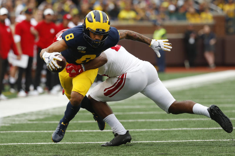 Michigan wide receiver Ronnie Bell (8) tries to break the tackle of Rutgers defensive back Jarrett Paul (25) in the first half of an NCAA college football game in Ann Arbor, Mich., Saturday, Sept. 28, 2019. (AP Photo/Paul Sancya)
