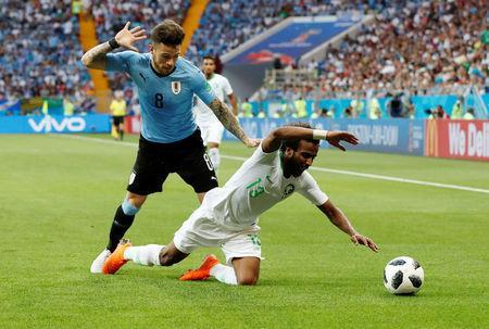 Soccer Football - World Cup - Group A - Uruguay vs Saudi Arabia - Rostov Arena, Rostov-on-Don, Russia - June 20, 2018 Saudi Arabia's Yasser Al-Shahrani in action with Uruguay's Nahitan Nandez REUTERS/Carlos Garcia Rawlins