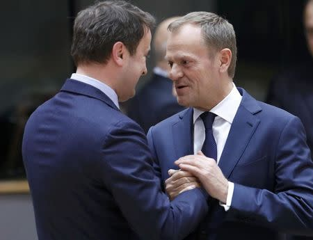 European Council President Donald Tusk (R) speaks with Luxembourg's Prime Minister Xavier Bettel at the EU summit Brussels, Belgium, March 9, 2017.    REUTERS/Yves Herman