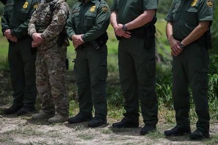 U.S. Border Patrol agents stand at attention during a 'Border Safety Initiative' media event at the U.S.-Mexico border in Mission