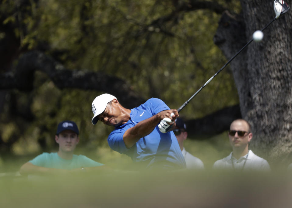 Tiger Woods hits his drive from the eighth tee during round-robin play at the Dell Match Play Championship golf tournament, Wednesday, March 27, 2019, in Austin, Texas. (AP Photo/Eric Gay)
