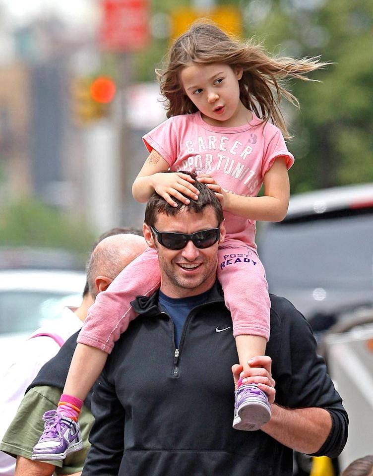 """Aussie actor Hugh Jackman gave his daughter Ava a lift on the streets of New York. 893/<a href=""""http://www.splashnewsonline.com"""" target=""""new"""">Splash News</a> - May 17, 2010"""