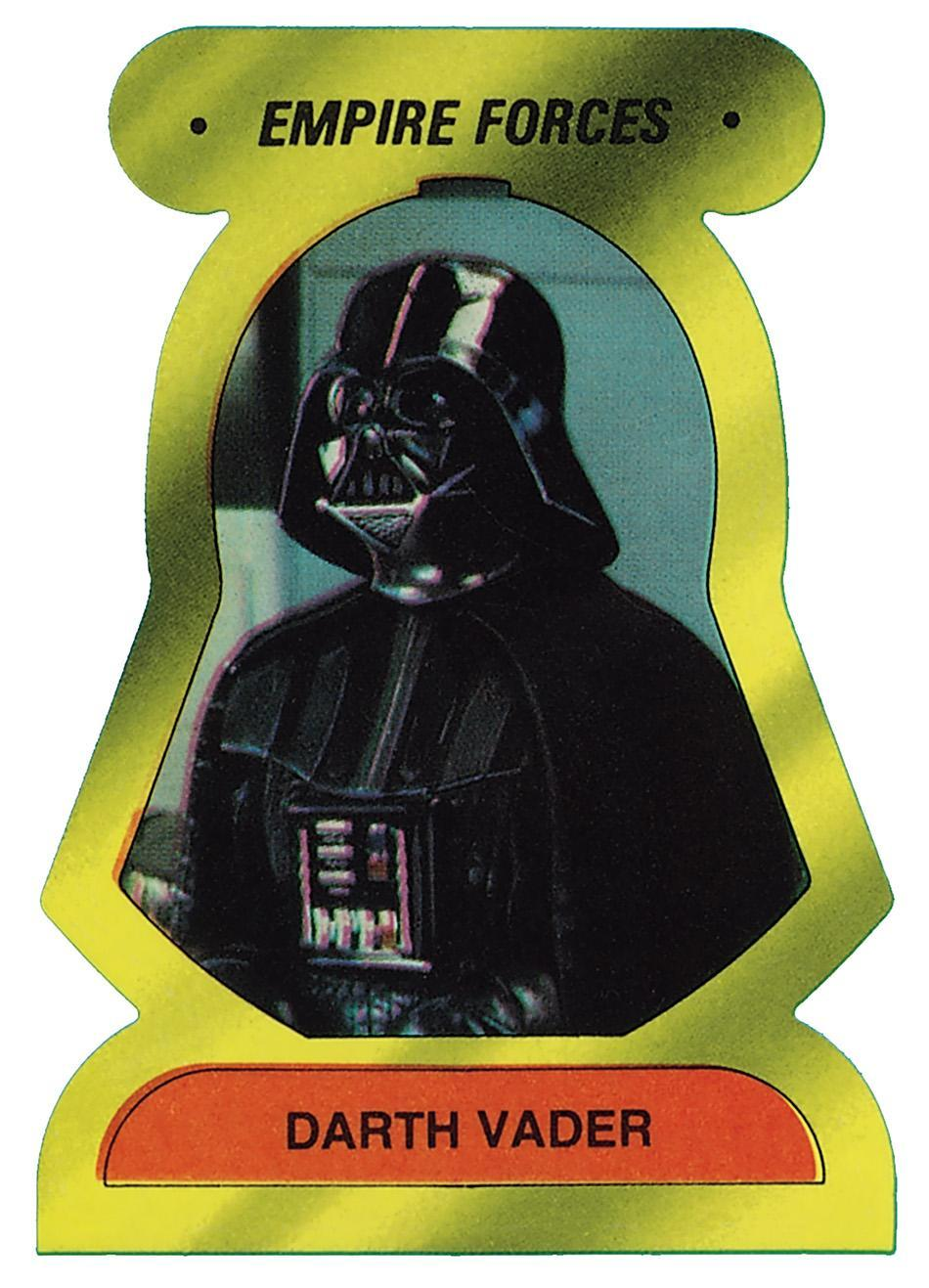 <p>For <em>The E</em><i>mpire Strikes Back</i>, Topps released stickers shaped like the dark lord's helmet. (Credit: The Topps Company and Lucasfilm Ltd (C) Abrams Books) </p>