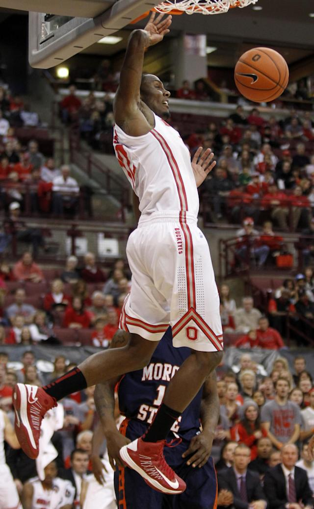 Ohio State's Sam Thompson, left, dunks the ball in front of Morgan State's Anthony Hubbard during the second half of an NCAA college basketball game in Columbus, Ohio, Saturday, Nov. 9, 2013. Ohio State won 89-50. (AP Photo/Paul Vernon)