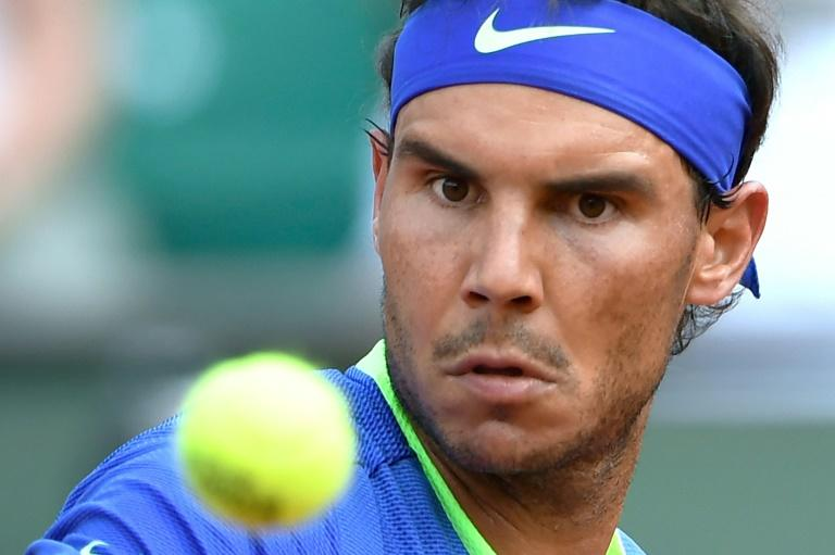 Nadal romps into 11th French Open quarters