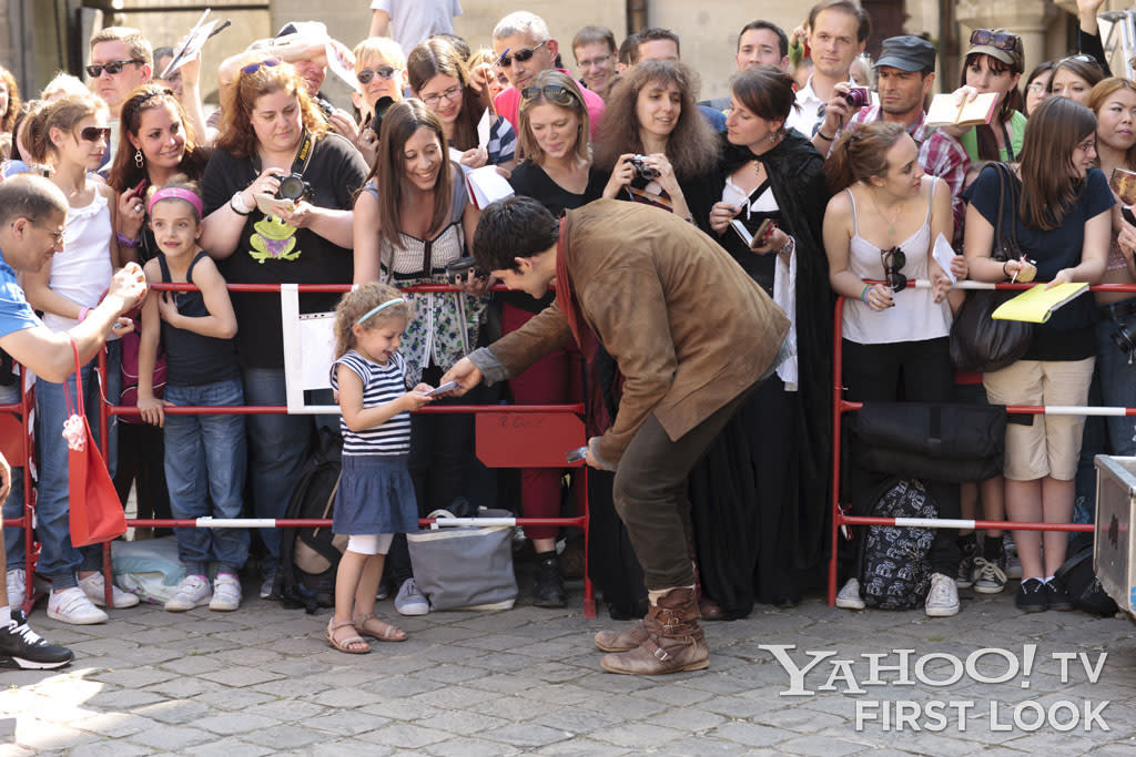 Actor Colin Morgan takes time out of production to greet the fans who invariably showed up at Chateau Pierrefonds to watch the filming of Merlin.
