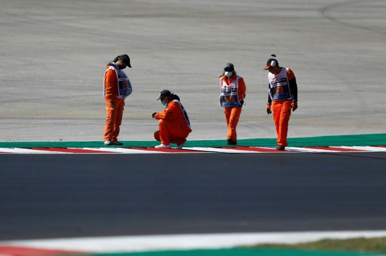 Track marshals inspect the track before qualifying