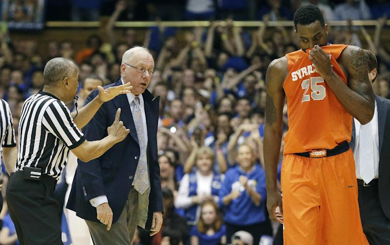 Syracuse coach Jim Boeheim is called for a technical foul by an official as Rakeem Christmas (25) walks away during the second half of an NCAA college basketball game against Duke in Durham, N.C., Saturday, Feb. 22, 2014. Duke won 66-60. (AP Photo/Gerry Broome)