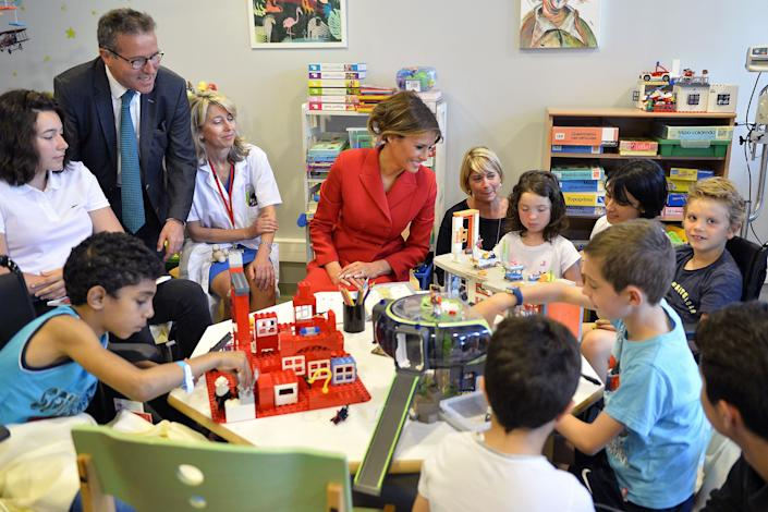 First Lady Melania Trump speaks with children as she visits Necker Hospital for children on July 13, 2017 in Paris, France.