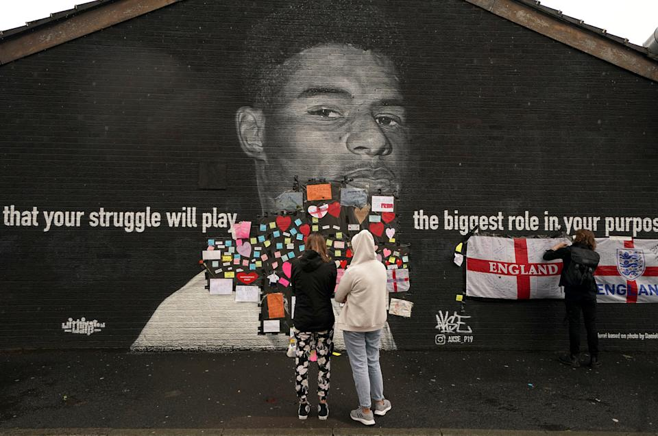 Messages of support that were placed on top of bin liners that were taped over offensive wording on the mural of Manchester United striker and England player Marcus Rashford on the wall of the Coffee House Cafe on Copson Street, Withington, which appeared vandalised the morning after the England football team lost the UEFA Euro 2021 final. Picture date: Monday July 12, 2021.