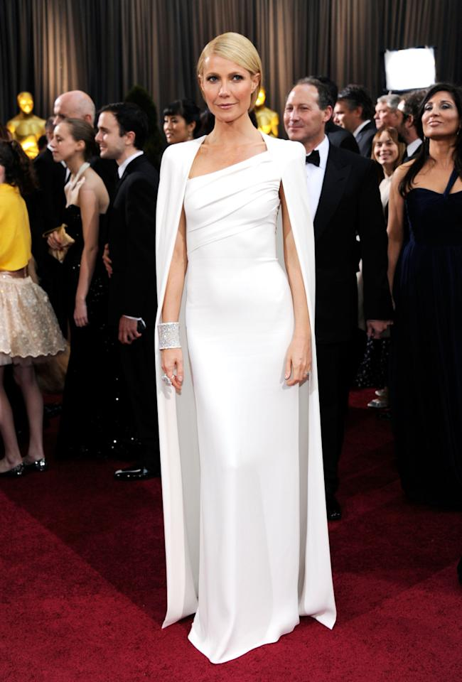 <p>You've got to hand it to Gwynnie – she knows how to jump on a trend. Years before the award shows red carpets really became saturated with caped gowns, Paltrow showed up to the 2012 Oscars in this white hot Tom Ford creation. <i>(Photo by Ethan Miller/Getty Images)</i><br /></p>