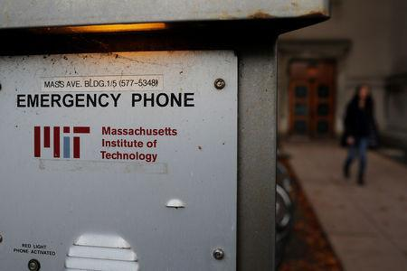 A woman walks past an emergency phone outside a building at the Massachusetts Institute of Technology (MIT) in Cambridge, Massachusetts, U.S., November 21, 2018. REUTERS/Brian Snyder