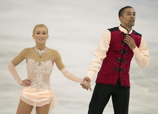 Aliona Savchenko and Robin Szolkowy of Germany leave the ice after competing in the pairs free skate figure skating competition at the Iceberg Skating Palace during the 2014 Winter Olympics, Wednesday, Feb. 12, 2014, in Sochi, Russia. (AP Photo/Ivan Sekretarev)