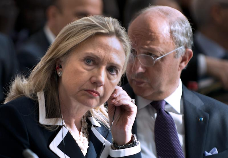 "FILE - In this July 6, 2012 file photo, U.S. Secretary of State Hillary Rodham Clinton and French Foreign Minister Laurent Fabius attend the ""Friends of Syria"" conference in Paris. The United States is readying new sanctions on Syrian President Bashar Assad's regime and its allies as Clinton heads to Turkey on Friday, Aug. 10, 2012, for weekend talks with top Turkish officials and Syrian opposition activists. (AP Photo/Brendan Smialowski, Pool, File)"