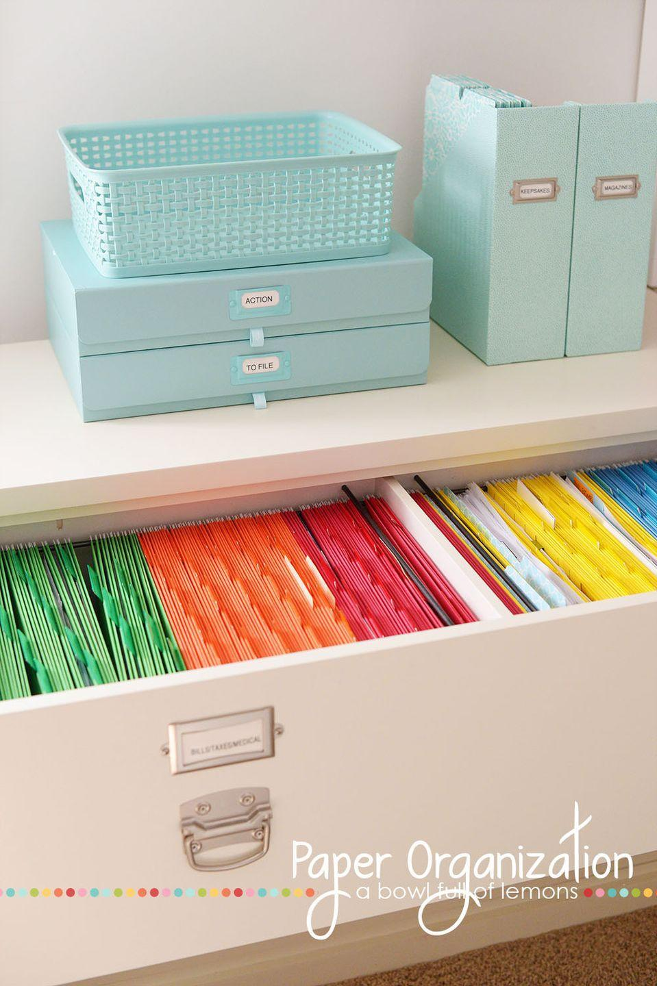 """<p>Manilla file folders have nothing on this pristine color-coded set. Finding important papers barely requires reading labels — just a glance toward the right color to find exactly what you need fast. </p><p><em><em><a href=""""http://www.abowlfulloflemons.net/2014/02/paper-organization.html"""" rel=""""nofollow noopener"""" target=""""_blank"""" data-ylk=""""slk:Get the tutorial at A Bowl Full of Lemons »"""" class=""""link rapid-noclick-resp"""">Get the tutorial at A Bowl Full of Lemons »</a></em></em></p><p><strong>RELATED: </strong><a href=""""https://www.goodhousekeeping.com/home/organizing/g3351/how-to-organize-your-paperwork/"""" rel=""""nofollow noopener"""" target=""""_blank"""" data-ylk=""""slk:How to Organize Your Paperwork"""" class=""""link rapid-noclick-resp"""">How to Organize Your Paperwork </a><br></p>"""