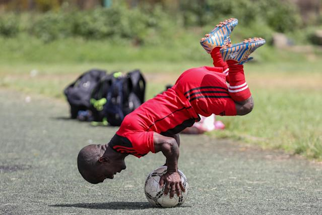 XDI11. Nairobi (Kenya), 29/05/2018.- A player of the Lion Stars, Kenya's first dwarf soccer team, balances on a ball during a training session at the City Stadium in Nairobi, Kenya, 29 May 2018 (issued 14 July 2018). Lion Stars is an eight member men's dwarf soccer team, the first of their kind in Kenya, with players aged between 18 and 47 years old. Led by Gabriel Ochieng, a volunteer coach, the team aims transition from a recreational to a competitive one. They are planning to head to Argentina for the Copa Argentina tournament in October 2018 for friendly matches they have been invited to. Dwarf soccer has different rules to the mainstream version, in the interests of player safety. Headers are banned, for instance, to prevent spinal injuries, and if a player heads the ball, the other team will be awarded a free kick. Lion Stars is the only dwarf soccer team in East Africa and is working towards bringing Tanzania, Uganda and Rwanda into the fold. However, the team is facing several challenges, including financial sponsorship that would enable them to further their sporting endeavors. 'We face the challenge of ground, we face a challenge of balls, we face challenge of corns, we face challenge of uniform,' volunteer coach Ochieng said. They have reached out to the Kenyan government and well-wishers for help. The team was established with the help of the 'Short Stature Society of Kenya' to help counter stigmatization against people of short stature in the country by engaging in activities such as motivational speaking, theater, and community work as well as sporting activities such as weight-lifting, badminton and soccer. (Futbol, Amistoso, Kenia, Ruanda) EFE/EPA/DANIEL IRUNGU ATTENTION: This Image is part of a PHOTO SET