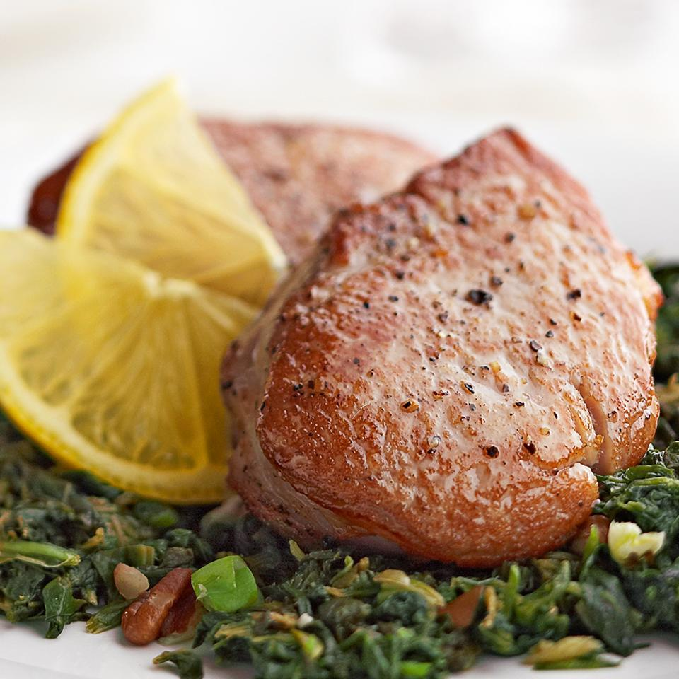"<p>This simple pork dinner can serve as a casual family supper, but it's also great for entertaining. The spinach acts as the side dish, making this recipe a complete meal. <a href=""http://www.eatingwell.com/recipe/269345/pork-medallions-with-lemon-pecan-spinach/"" rel=""nofollow noopener"" target=""_blank"" data-ylk=""slk:View recipe"" class=""link rapid-noclick-resp""> View recipe </a></p>"