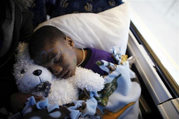 Gregory, 6, sleeps on the bus back to Los Angeles, after visiting his father at San Quentin state prison in San Quentin, California June 8, 2012.