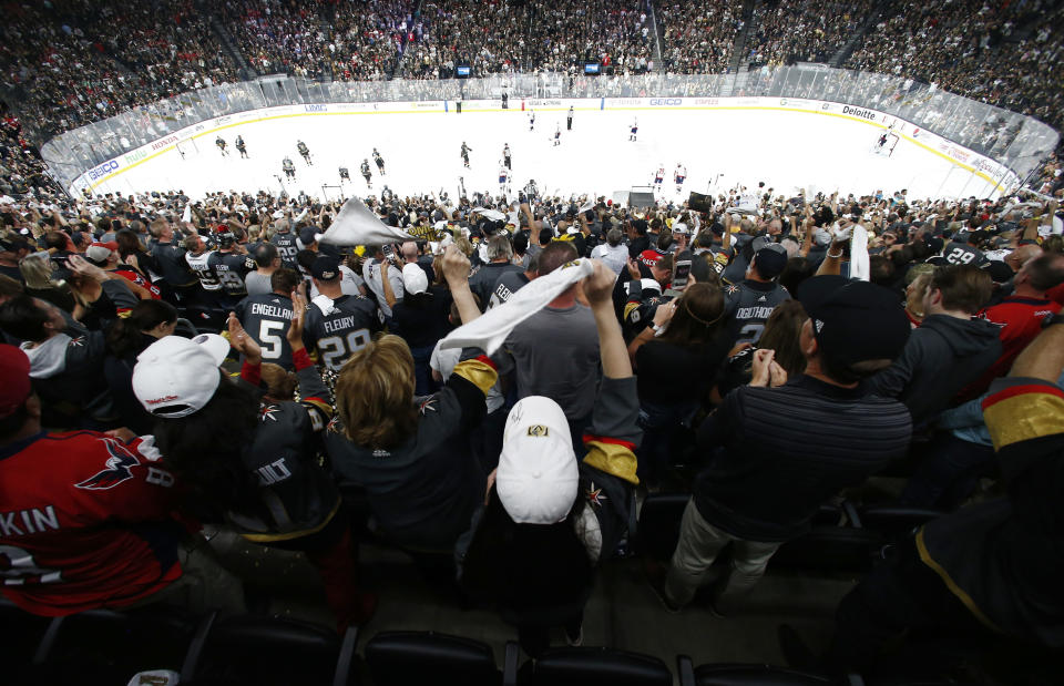 FILE - In this May 28, 2018, file photo, fans celebrate a goal by Vegas Golden Knights left wing Tomas Nosek, of the Czech Republic, during the third period in Game 1 of the NHL hockey Stanley Cup Finals against the Washington Capitals, in Las Vegas. The Detroit Red Wings are desperately trying to keep fans filing into Little Caesars Arena while the allure of the relatively new facility wears off while the team goes through a painful rebuild. Every other team in the NHL _ and other leagues _ is also trying to give spectators good reason to come to the arena instead of enjoying games on TV from home or the local watering hole. (AP Photo/Ross D. Franklin, File)