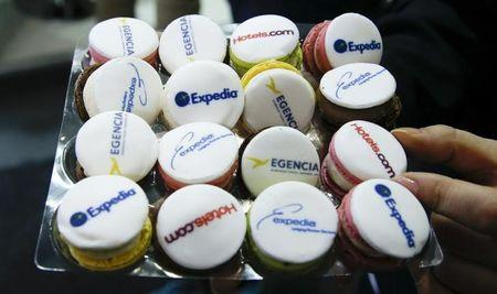 Macaroons with the logos of Expedia.com, Hotel.com and other brands are pictured at the stand of global online travel brand Expedia.com during the International Tourism Trade Fair (ITB) in Berlin, Germany, March 9, 2016. REUTERS/Fabrizio Bensch/Files