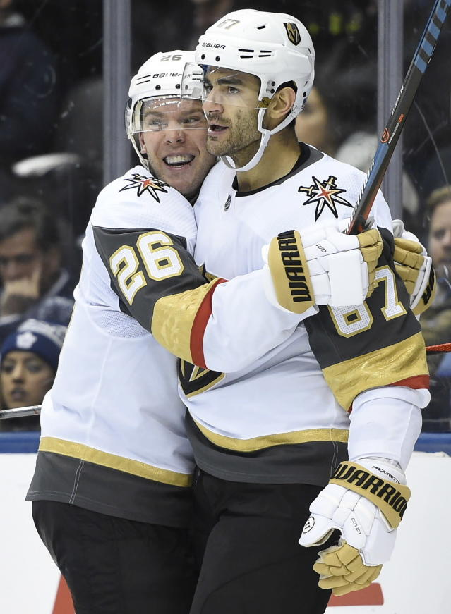 Vegas Golden Knights left wing Max Pacioretty (67) celebrates his goal against Toronto Maple Leafs goaltender Frederik Andersen with center Paul Stastny (26) during the third period of an NHL hockey game Thursday, Nov. 7, 2019, in Toronto. (Nathan Denette/The Canadian Press via AP)