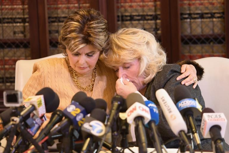 Attorney Gloria Allred, left, comforts her client Heather Kerr, who says disgraced Hollywood producer Harvey Weinstein unzipped his pants and forced himself on her when she was an aspiring actress in her 20s