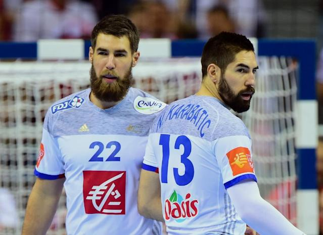 France' Luka Karabatic (left) and his brother Nikola Karabatic in action against Serbia during the 2016 European Handball Championships in Krakow (AFP Photo/ATTILA KISBENEDEK)