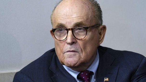 PHOTO: Rudy Giuliani listens as President Donald Trump speaks during a news conference at the White House in Washington, D.C., Sept. 27, 2020. (Chris Kleponis/Polaris/Bloomberg via Getty Images, FILE)