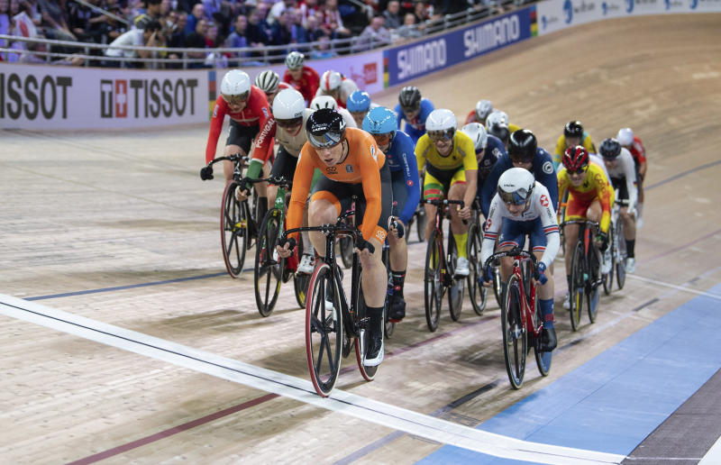 Kirsten Wild from the Netherlands leads the pack across the line during the World Championships Scratch women's track cycle race in Berlin, Germany, Wednesday Feb. 26, 2020. Wild won the event. (Sebastian Gollnow/dpa via AP)