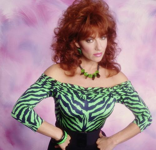"""<div class=""""caption-credit""""> Photo by: Fox</div><b>Peggy Bundy on """"Married... With Children""""</b> <br> Some say cheap and tacky, we say unique and highly entertaining. There's a reason Peggy is imitated every Halloween! Leopard print, gold lamé, and leggings were Mrs. Bundy's best friends decades before they became staples at American Apparel. Her accessories of choice include big earrings, plastic jewelry, and a big red bouffant. Our burning question: how does she pull off her skin-tight outfits while eating nothing but Bonbons?!"""
