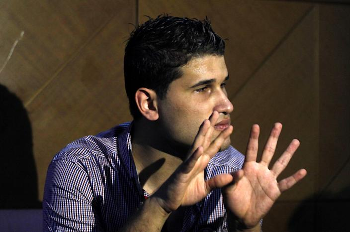 Fahd al-Bakoush, a freelance videographer, 22, discusses a video he shot that shows civilians removing the body of U.S. Ambassador Chris Stevens from a small dark room in the U.S. consulate in Benghazi in the aftermath of the Tuesday Sept. 11, 2012, attack, during an interview with the Associated Press, in Benghazi, Libya, Monday, Sept. 17, 2012. Stevens and three other Americans were killed in the attack on the consulate as part of a wave of assaults on U.S. diplomatic missions in Muslim countries over a low-budget movie made in the United States that denigrates the Prophet Muhammad. (AP Photo/Mohammad Hannon)