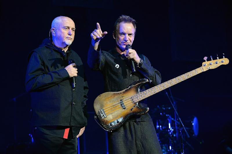 """Peter Gabriel (L) and Sting perform on stage during the """"Rock, Paper, Scissors"""" tour opener at Nationwide Arena on June 21, 2016 in Columbus, Ohio (AFP Photo/Kevin Mazur)"""
