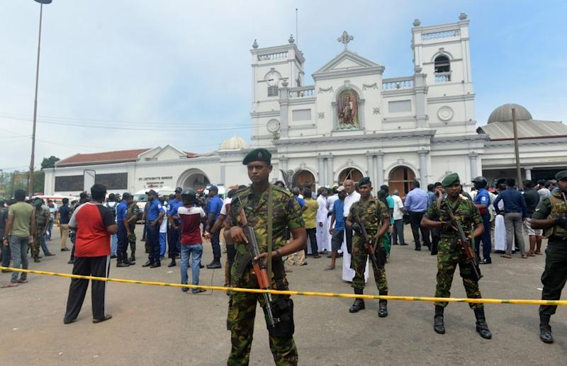 Sri Lankan security personnel keep watch outside the church premises following a blast at the St. Anthony's Shrine in Kochchikade, Colombo on April 21, 2019. — AFP pic