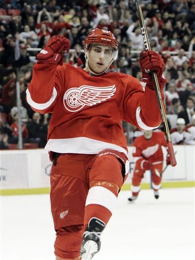 Detroit Red Wings center Valtteri Filppula. of Finland, celebrates his goal against the Phoenix Coyotes in the first period of an NHL hockey game in Detroit, Thursday, Jan. 12, 2012. (AP Photo/Paul Sancya)