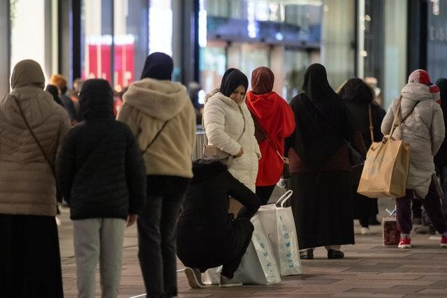 Shoppers queue outside Next in Leicester (Joe Giddens/PA)