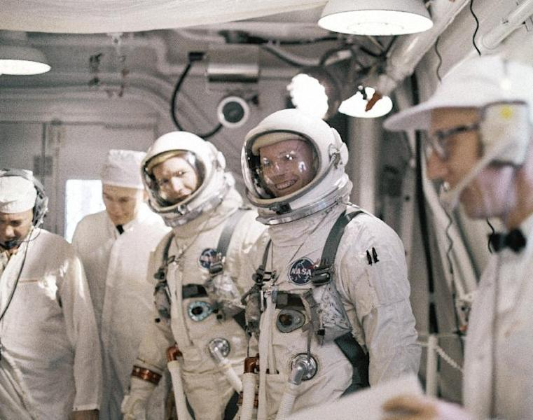 """FILE - In this March 16, 1966 file photo, astronauts Neil A. Armstrong, fourth from left, and David R. Scott, third from left, arrive at Complex 19 for a simulated test in preparation for flight. The family of Neil Armstrong, the first man to walk on the moon, says he died Saturday, Aug. 25, 2012, at age 82. A statement from the family says he died following complications resulting from cardiovascular procedures. It doesn't say where he died. Armstrong commanded the Apollo 11 spacecraft that landed on the moon July 20, 1969. He radioed back to Earth the historic news of """"one giant leap for mankind."""" Armstrong and fellow astronaut Edwin """"Buzz"""" Aldrin spent nearly three hours walking on the moon, collecting samples, conducting experiments and taking photographs. In all, 12 Americans walked on the moon from 1969 to 1972. (AP Photo/File)"""