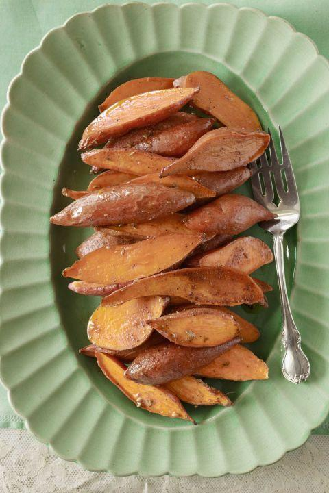 "Here roasted sweet potatoes are slathered with a spiced and sugared butter. Delicious as a side dish or as a simple appetizer, this easy recipe is sure to satisfy. <a href=""https://www.countryliving.com/recipefinder/spiced-sweet-potatoes-recipe-clx0411?click=recipe_sr"" rel=""nofollow noopener"" target=""_blank"" data-ylk=""slk:Get the recipe."" class=""link rapid-noclick-resp""><strong>Get the recipe.</strong></a>"