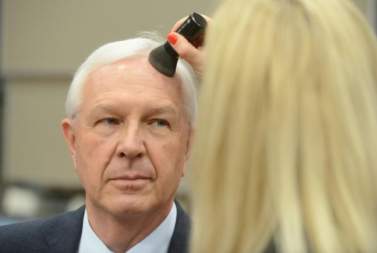 "Czech presidential candidate Jiri Drahos, seen here being made up before a debate, is a mild-mannered liberal centrist whom some critics have written off as ""wishy-washy"""