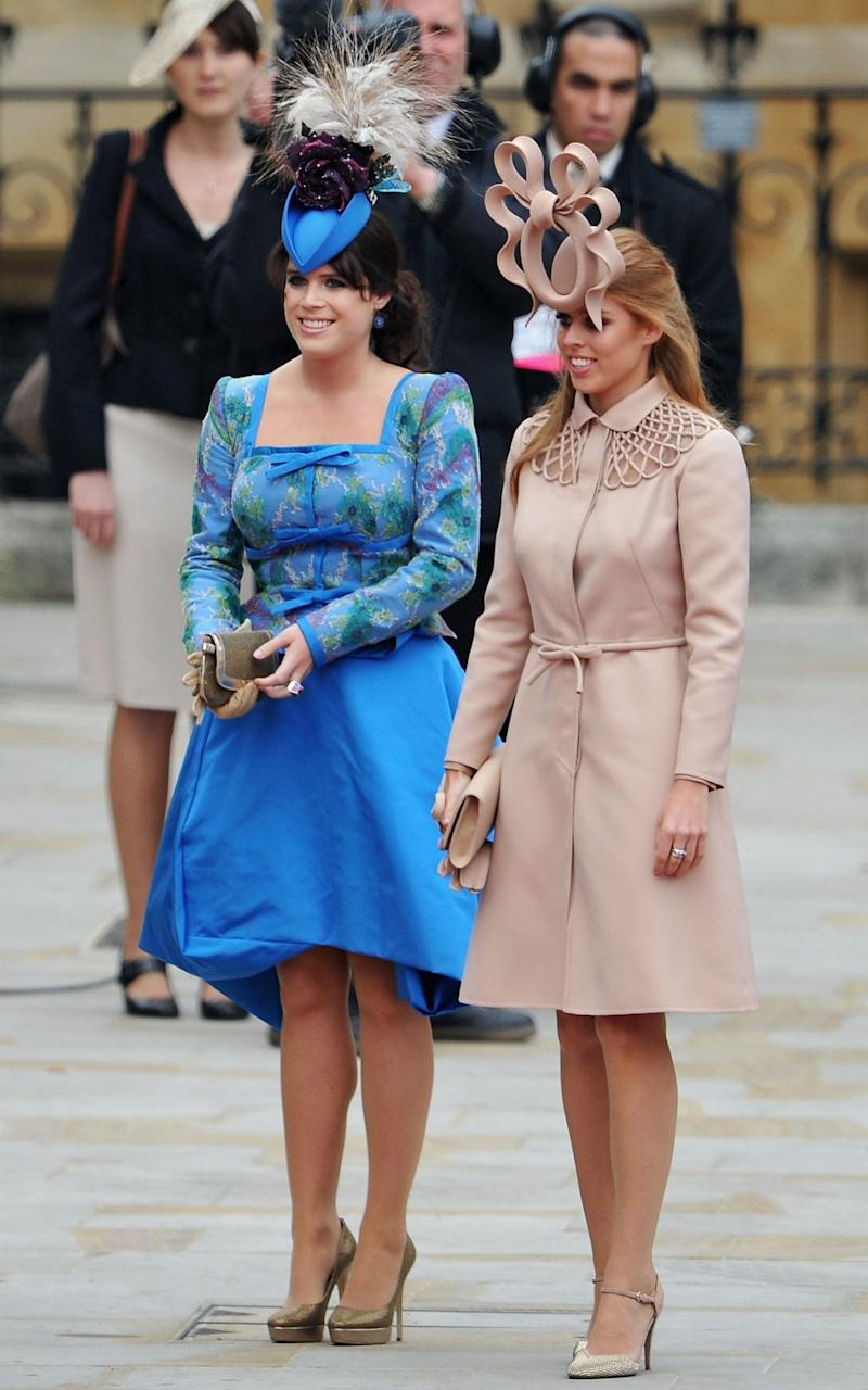 Princesses Beatrice and Eugenie at the wedding of Prince William to Kate Middleton in 2011 - Getty