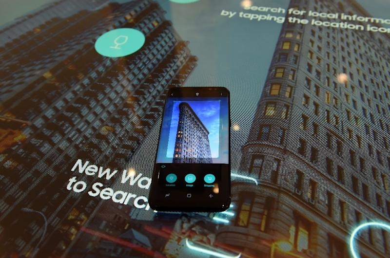 The new Samsung S8, incorporating its virtual assistant Bixby, seen on display in New York (AFP Photo/Timothy A. Clary)