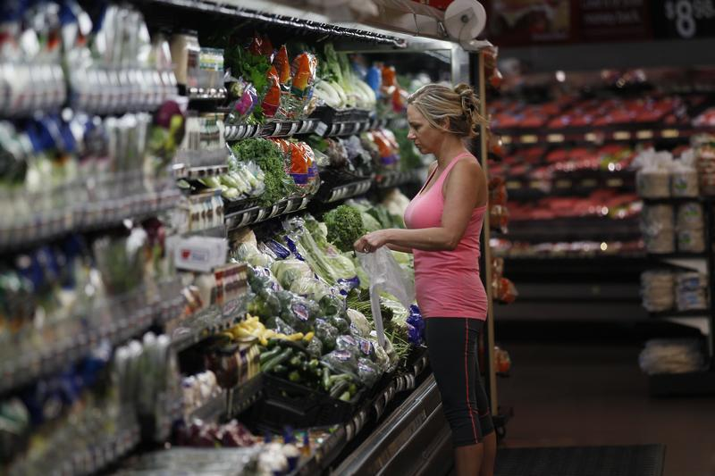 A customer shops at a Walmart Supercenter in Rogers
