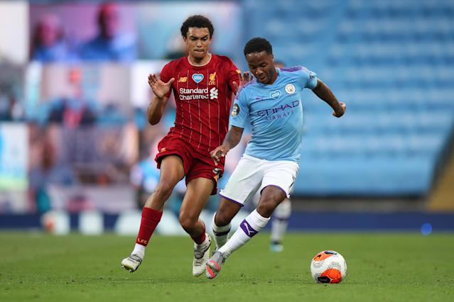 Raheem Sterling (right) scored twice as Manchester City hammered Liverpool. (Photo by Robbie Jay Barratt - AMA/Getty Images)