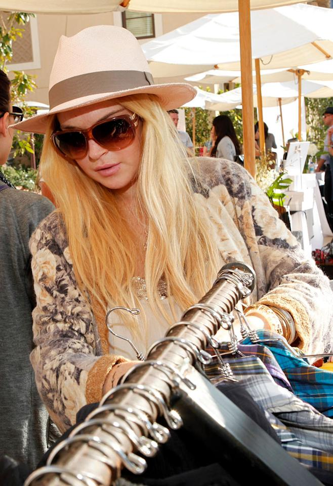 """Meanwhile, Lindsay Lohan opted to browse the racks solo. Too bad there wasn't a section of clothes specially designed to cover an alcohol-monitoring ankle bracelet. Jordin Althaus/<a href=""""http://www.wireimage.com"""" target=""""new"""">WireImage.com</a> - June 3, 2010"""