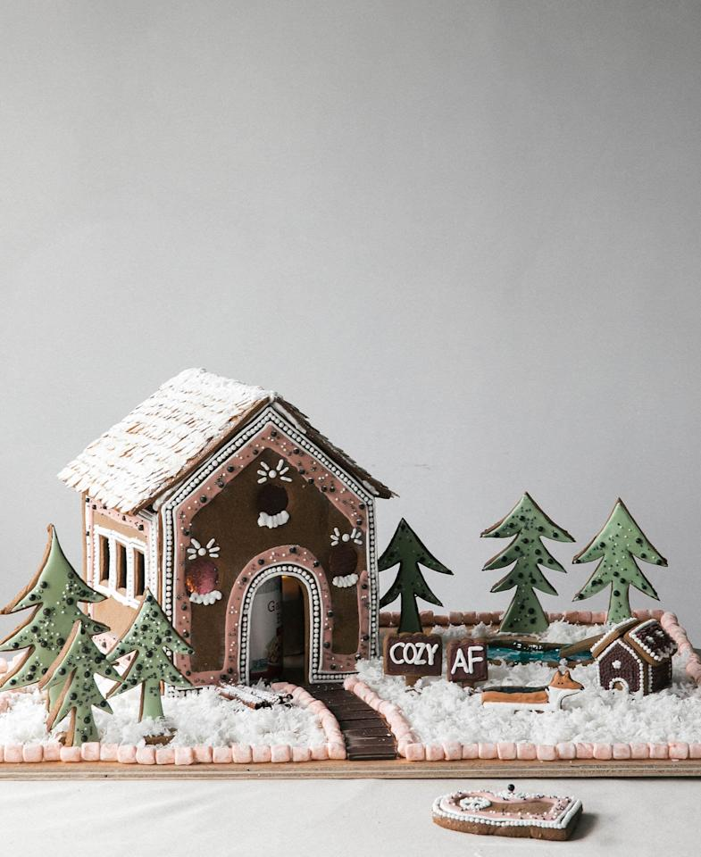 """<p>Create the perfect seasonal display when you make a cozy gingerbread house. We won't tell if you take a couple bites of the exterior!</p> <p><strong>Get the recipe:</strong> <a href=""""https://www.acozykitchen.com/cozy-gingerbread-house"""" target=""""_blank"""" class=""""ga-track"""" data-ga-category=""""Related"""" data-ga-label=""""https://www.acozykitchen.com/cozy-gingerbread-house"""" data-ga-action=""""In-Line Links"""">cozy gingerbread house</a></p>"""
