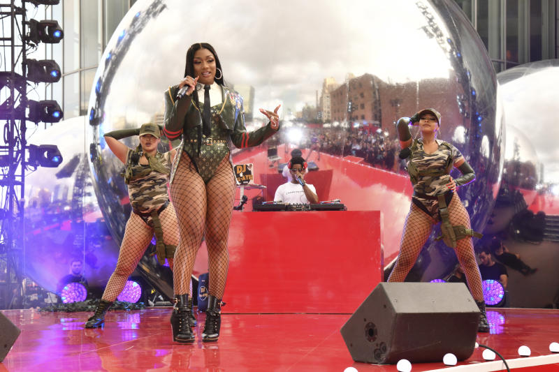 """FILE - In this Aug. 26, 2019, file photo, Megan Thee Stallion performs at the MTV Video Music Awards at the Prudential Center in Newark, N.J. The singer says she works extremely hard in the studio when it comes to writing music, so when she almost couldn't release her new album due to drama with her record label, she was anxious and uneasy. """"I was super-nervous,"""" she said in an interview with The Associated Press this week after a Houston judge ordered the Friday, March 6, 2020, release of her album as her bitter court battle with her label continues. (Photo by Charles Sykes/Invision/AP, File)"""