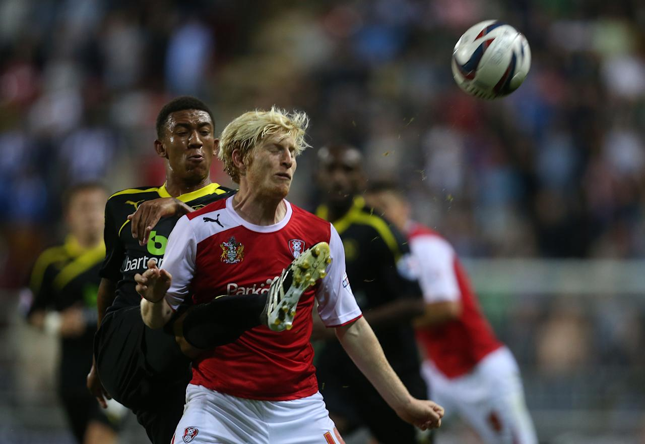 Sheffield Wednesday's Liam Palmer (left) and Rotherham's Ben Pringle during the Capital One Cup, First Round match at the New York Stadium, Rotherham.