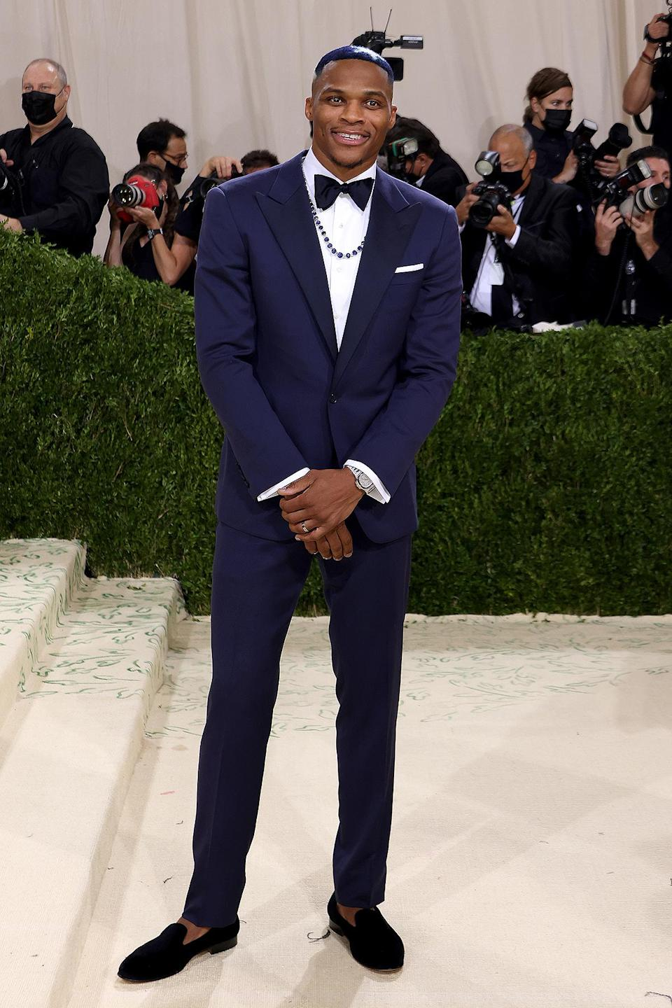 <p>The NBA player kept it classic in a Ralph Lauren navy tux and loafers, but topped off the look with his hair painted blue with white stars, a hair design created by Sarah Shears of One Eleven Lounge.</p>