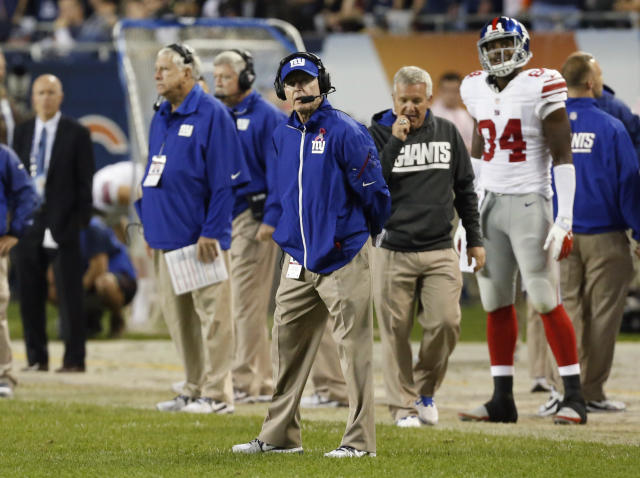 New York Giants coach Tom Coughlin looks at the scoreboard in the second half of an NFL football game against the Chicago Bears, Thursday, Oct. 10, 2013, in Chicago. The Bears won 27-21. (AP Photo/Charles Rex Arbogast)